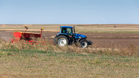 Tractor on field seeding Stock Images