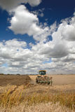 Tractor, Field, And Skies Royalty Free Stock Image