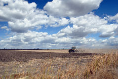 Tractor, Field, And Skies Stock Image