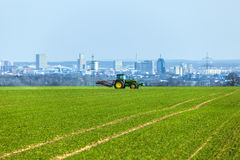 Tractor on the field with Skyline Stock Images