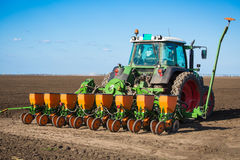 Tractor in the field sow Royalty Free Stock Photo