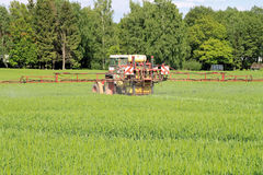 Tractor in field spraying Stock Photography