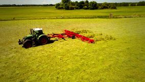 Tractor field two setting fly over. Tractor drives over green field stock video