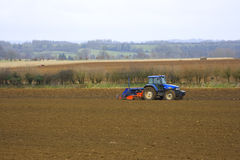 Tractor In fields Stock Images
