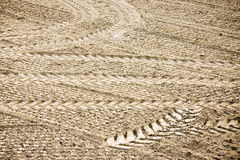 Tractor footprints on plowed field Stock Photo