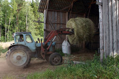 Tractor forklift mover, used to load round bale hay. Stock Image