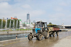 Tractor and fountains in Plotinka park, Yekaterinburg city, Russia Royalty Free Stock Photography