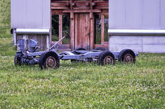 Tractor frame. Rusty tractor frame abandoned in the grass Royalty Free Stock Photo