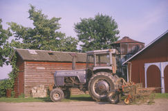 Tractor in front of a barn Stock Photo