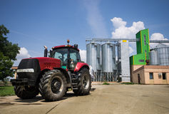 Tractor in front of silos Royalty Free Stock Photo