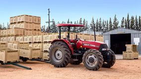 Tractor with fruit crates on farm. stock photos