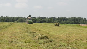 Tractor gather hay bale stock video