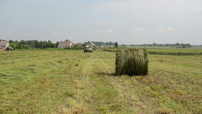 Tractor gather hay bale Royalty Free Stock Images