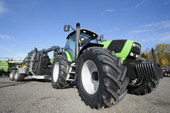 Tractor and giant tires. Farming tractor with large tires, all trademarks removed Stock Photos