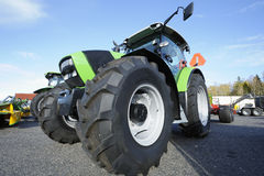 Tractor and giant tires. Farming tractor with large tires, all trademarks removed Royalty Free Stock Photo