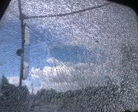 Tractor glass windows chappy hit with stone. And sky clouds and mirror .mobile royalty free stock photos