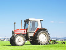 Tractor on grass Royalty Free Stock Image