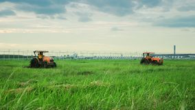 2 Tractor in grass field royalty free stock photos