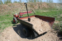 Tractor gravel transportion Royalty Free Stock Photography