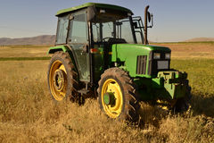 Tractor. Green farm yellow bale Stock Photography