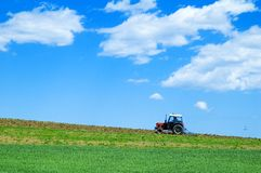 Tractor in green field Stock Photo