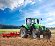 Tractor. Green tractor in the field stock image