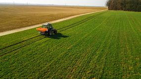 Tractor on a green field. Aerial survey stock photo