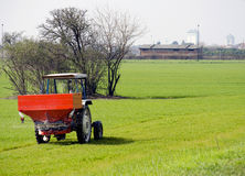 Tractor in a green field stock image