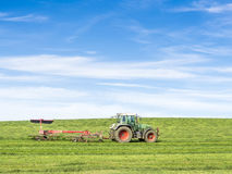 Tractor on green meadow Stock Images