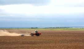 A tractor handles the ground Stock Photography