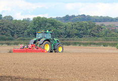 Tractor harrowing field. Royalty Free Stock Images