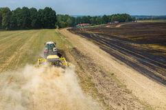 Tractor harrowing the field in fire Royalty Free Stock Photo