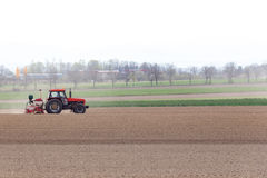 Tractor harrowing the field Royalty Free Stock Image