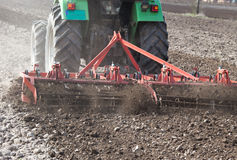 Tractor harrowing soil Royalty Free Stock Image
