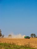 Tractor during harvest season Stock Images