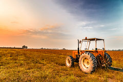 Tractor and harvested land stock photos