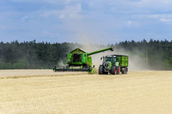 Tractor and harvester. On the field Stock Photos