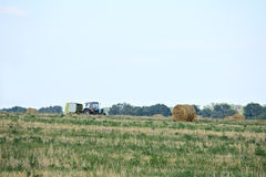 Tractor harvesting crop Royalty Free Stock Photo