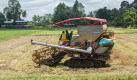A tractor harvesting the crops Stock Photo