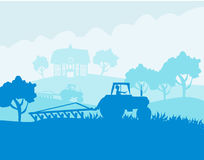 Tractor harvesting on a sunny day Royalty Free Stock Photos