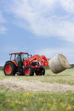 Tractor Hauling Round Bale Stock Photography