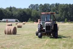 Tractor and Hay. Bales on a farm royalty free stock photography