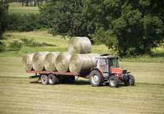 Tractor with hay bales. Tractor carrying hay bales at the farm Royalty Free Stock Image