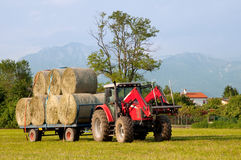 Tractor with hay bales barrow Stock Images