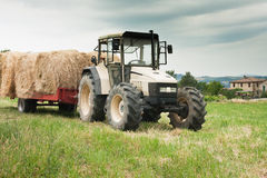Tractor with hay bales in Central Italy Stock Photo