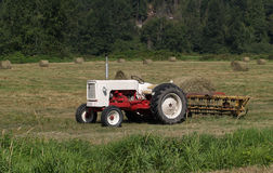Tractor in hay field Royalty Free Stock Image