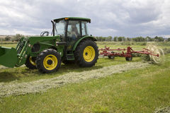 Tractor with hay rake Stock Photo
