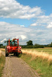 Tractor and hay tedder Stock Image
