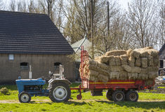 Tractor with hay wagon Royalty Free Stock Image