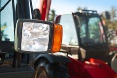 Tractor headlight, huge machine with light equipment. Stock Photos